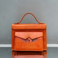 Justice Orange Crocodile Embossed Snake Leather Insert